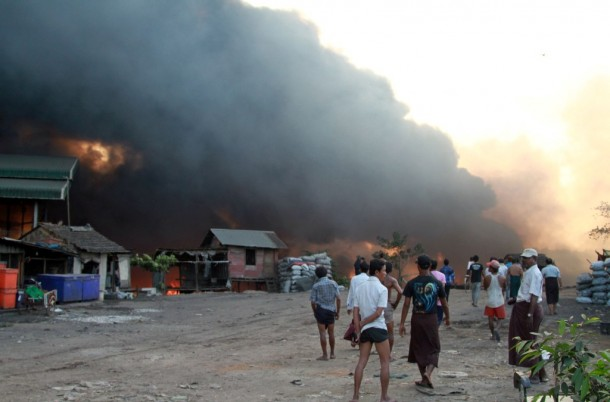 People gather near the riverside premises of Myawaddy Trade Company on Monday evening, where a blast on an oil tanker caused a fire to spread. (Photo: The Irrawaddy)