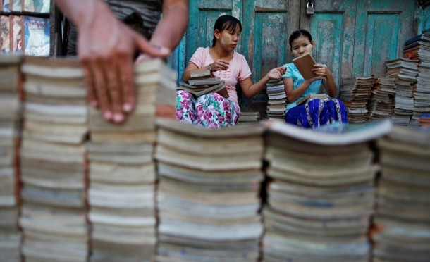 People sort used books for sale in the old part of Rangoon November 29, 2011. (Photo: Reuters)