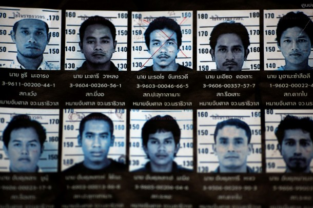 The photo of Mahrosu Jantarawadee (top row, center) is seen among others on a wanted poster at a police station in Bacho in the troubled southern province of Narathiwat on March 10. (Photo: Reuters/Damir Sagolj)