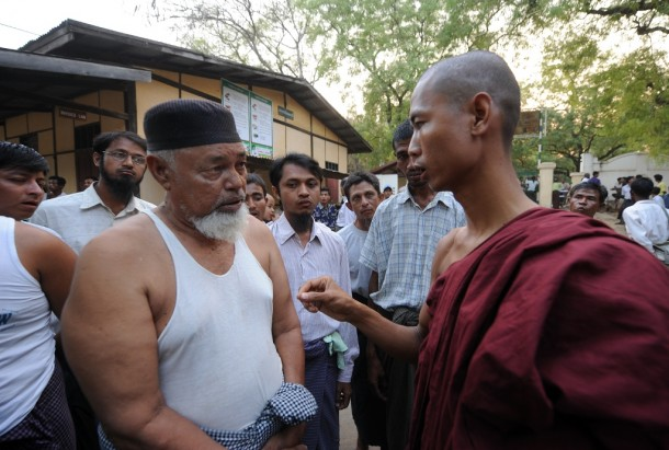 A Muslim man talks with a Buddhist monk at a school that temporarily houses Muslim refugees who were driven out of Meikhtila town during riots last week. (Photo: Steve Tickner / The Irrawaddy)