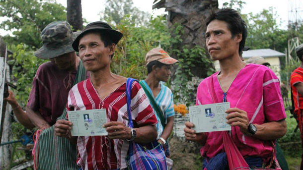 Karen IDPs show off their new identity cards following a ceremony in Kyaukkyi, Pegu Division. The Karen are among the ethnic groups that often lack ID cards due to displacement and decades of civil war. (Photo: Yangon Press International)