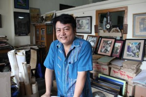 Aung Soe Min is pictured in his Pansodan Art Gallery, on Pansodan Street in downtown Rangoon. (Photo: Samantha Michaels / The Irrawaddy)