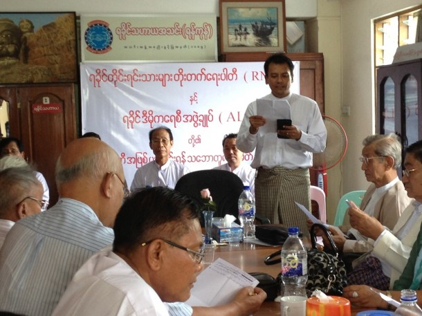 Members of the Rakhine Nationalities Development Party (RNDP) and the Arakan League for Democracy (ALD) hold a press conference on Monday in Rangoon, announcing a decision to merge the two parties. (Photo: Zarni Mann / The Irrawaddy)