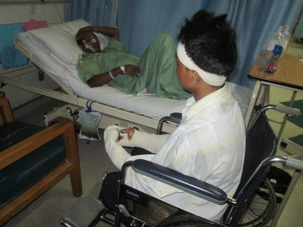 Two injured Burmese nationals are pictured at a hospital in Kaula Lumpur. (Photo: The Irrawaddy)