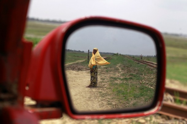 A woman from a Rohingya internally displaced persons (IDP) walks along a railway line back to her camp after sheltering from Cyclone Mahasen in a mosque outside of Sittwe, Arakan State, on May 17, 2013. (Photo: Reuters /Soe Zeya Tun)