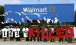 Protesters hold up a sign commemorating those killed in recent clothing factory tragedies in Bangladesh outside Wal-Mart Stores Inc. headquarters in Bentonville, Arkansas, on June 5, 2013. (Photo: Reuters / Rick Wilking)