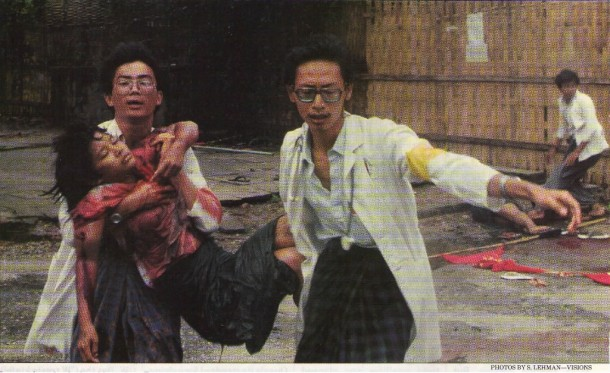 The iconic photo in which house surgeons Win Zaw (L) and Saw Lwin carry 16-year-old pro-democracy protestor Win Maw Oo to an ambulance after she was fatally shot on September 18, 1988. (Photo: S. Lehman / Visions)