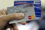 Private banks in Burma are working with United States-based VISA and Mastercard to issue bank cards that can be used overseas. (Photo: JPaing / The Irrawaddy)