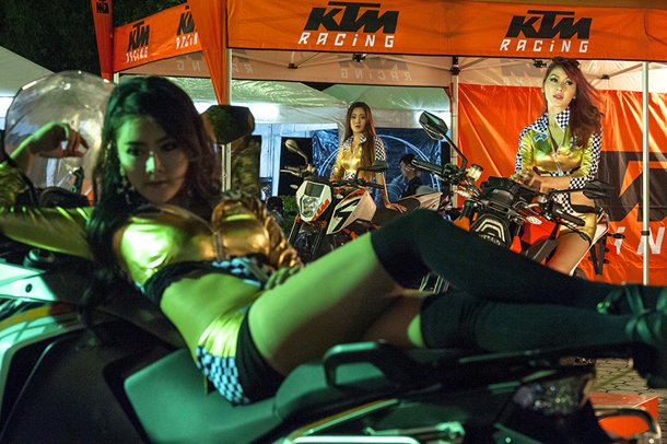 A model poses on a motorcycle at the Real Biker Custom Show. (Photo: Brennan O'Connor / The Irrawaddy)