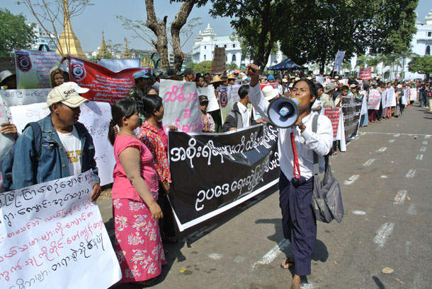 A farmer calls through a megaphone at a protest in Rangoon on Saturday calling for the return of seized land around the country. (Photo: Simon Lewis / The Irrawaddy)