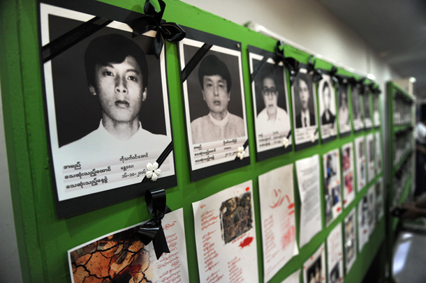 Photographs of former political prisoners are seen at an event honoring those who died in custody after being locked up by Burma's military regime. (Photo: Steve Tickner / The Irrawaddy)