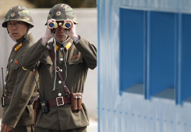 North Korean soldiers look to the South as they patrol at the truce village of Panmunjom in the demilitarized zone separating the North from South Korea in Paju, on March 19, 2013. (Photo: Reuters)