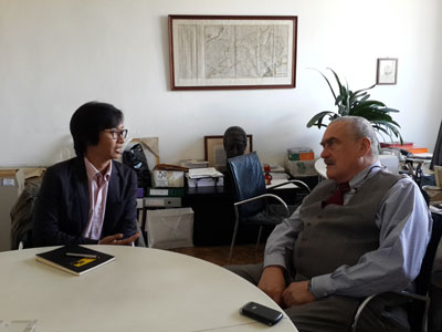 Kyaw Zwa Moe, left, editor of The Irrawaddy magazine's English-language edition, speaks with Karel Schwarzenberg, a former deputy prime minister and minister of foreign affairs for the Czech Republic, in Prague. (Photo: The Irrawaddy)