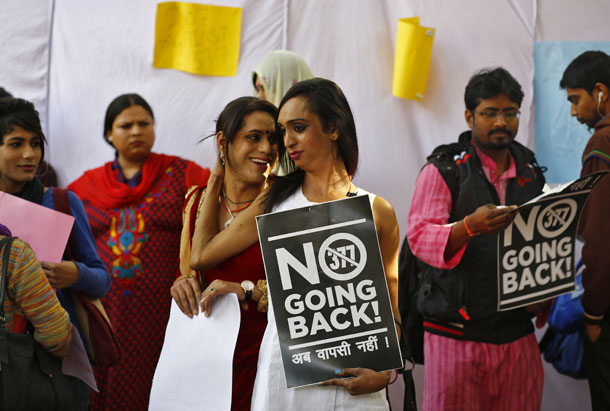 Gay rights activists hold placards during a protest in New Delhi on Feb. 11, 2014, demanding the review of a ruling by Indian Supreme Court that banned gay sex in India.