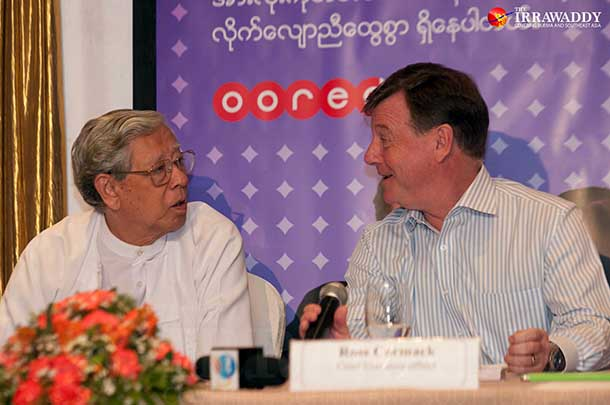 Ooredoo Myanmar CEO Ross Cormack (R) during a press conference on Sunday. (Photo: Sai Zaw / The Irrawaddy)