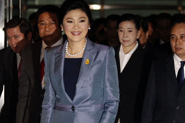 Thailand's Prime Minister Yingluck Shinawatra is seen smiling as she arrived at the Constitutional Court in Bangkok on Tuesday. The court ordered Yingluck to step down Wednesday after she was found guilty of abuse of power. (Photo: Reuters)