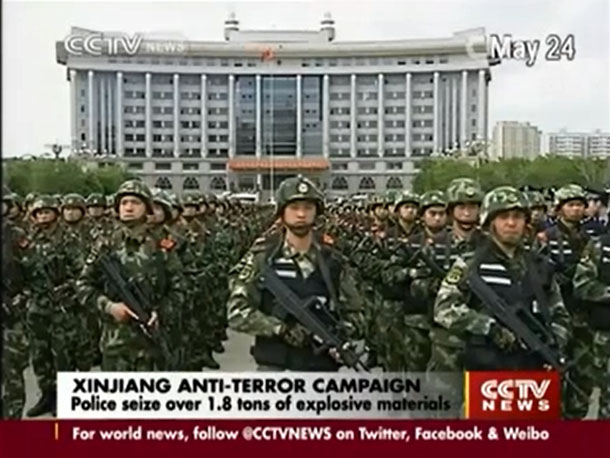 Chinese soldiers are shown on state television taking up position in Urumqi, capital of the Xinjiang Uyghur Autonomous Region, following a deadly attack in the city on May 22, 2014. (Photo: CCTV / Youtube)