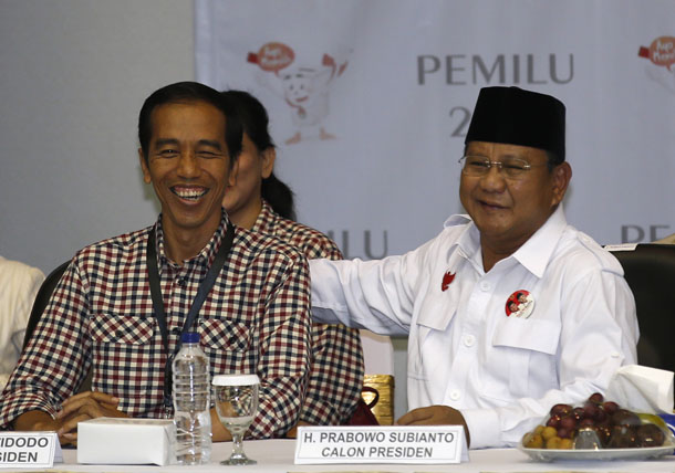 "Indonesian presidential candidates Joko ""Jokowi"" Widodo, left, and Prabowo Subianto smile as they attend a ceremony to draw ballot numbers at the Election Commission in Jakarta on June 1, 2014. (Photo: Reuters)"