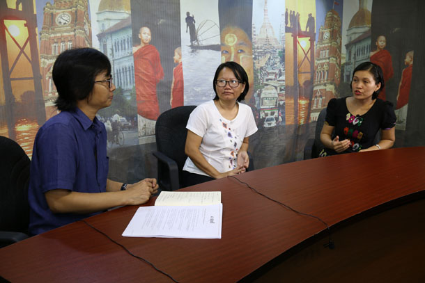 "Kyaw Zwa Moe, left, editor of the English edition of The Irrawaddy magazine, speaks with Kachin activists Khon Ja, center, and May Sabe Phyu, right, during this week's episode of ""Dateline Irrawaddy."""