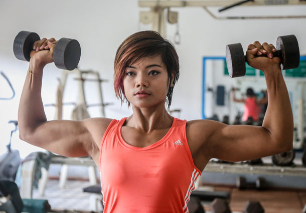 Aye Aye Soe, 24, became the first female Burmese bodybuilder to win a gold medal in a competition. (Photo: JPaing / The Irrawaddy)