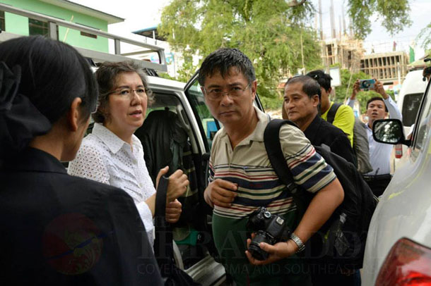 Yanghee Lee, the new UN human rights rapporteur on Burma (wearing a white shirt), and her staff prepare to enter a car in Mandalay on Tuesday. (Photo: Teza Hlaing / The Irrawaddy)