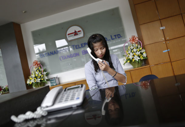 A staff member talks on the phone at the reception desk at the Yatanarpon Teleport (YTP) office in Rangoon on Sept. 17, 2013. (Photo: Reuters)