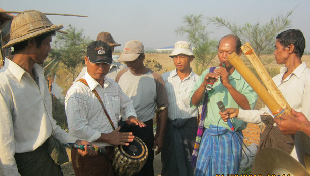 Farmers from Rangoon Division's Swepyitha Township play instruments during a protest in January 2013 to demand compensation for loss of their land. (Photo: Aye Kyawt Khaing / The Irrawaddy)