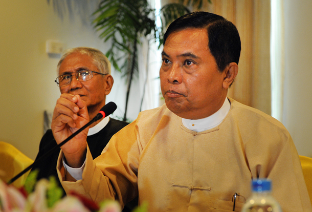 Information Minister Aung Kyi gestures during a press conference in Rangoon in August 2013. (Photo: Steve Tickner / The Irrawaddy)