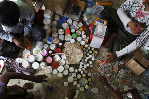 Medicine are seen in a pharmacy which also serves as a makeshift clinic at the Thae Chaung camp for internally displaced people in Sittwe, Arakan State, on April 22, 2014. (Photo: Minzayar / Reuters)