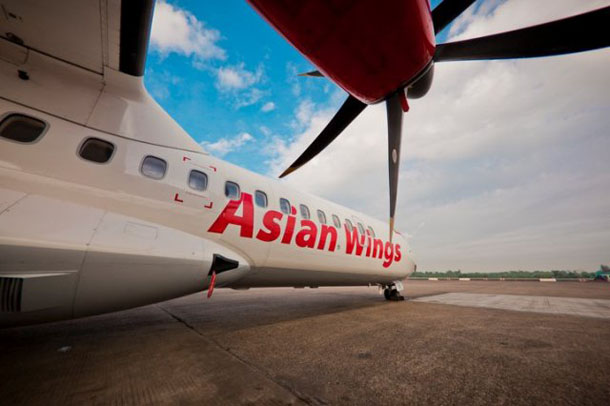 An Asian Wings prop plane is pictured on the tarmac. (Photo: asianwingsair.com)