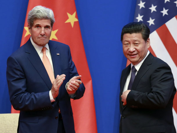 US Secretary of State John Kerry (left) applauds after China's President Xi Jinping gave his speech during the opening ceremony of the Sixth Round of US-China Strategic and Economic Dialogue at Diaoyutai State Guesthouse in Beijing July 9, 2014. (Photo: Reuters)