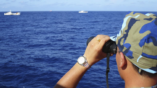 A crewman from the Vietnamese coastguard ship 8003 looks out at sea as Chinese coastguard vessels give chase to Vietnamese ships that came close to the Haiyang Shiyou 981, known in Vietnam as HD-981, oil rig in the South China Sea, on July 15, 2014. (Photo: Reuters)