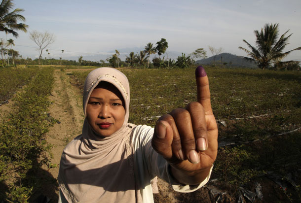 A voter poses for a picture after voting in Indonesia's presidential election in Brambang Darussalam, Bondowoso, East Java, on Wednesday. (Photo: Reuters)
