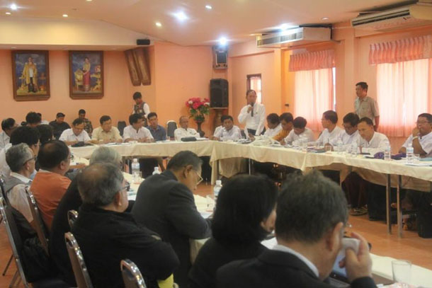 Senior 88 Generation leader Ko Ko Gyi, standing, speaks during a meeting between the UNFC and opposition political forces on the Thai-Burmese border on Friday, July 4, 2014. (Photo: The 88 Generation Peace and Open Society)
