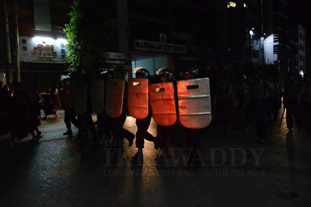 Riot police charge on 26th (B) Road of Mandalay on Tuesday evening. (Photo: Teza Hlaing / The Irrawaddy)