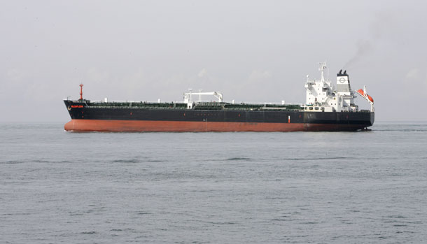 An oil tanker sails past Chemoil's Helios oil terminal on Singapore's Jurong Island February 28, 2008. (Photo: Reuters)