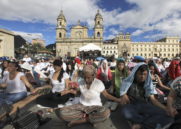 "People take part in ""The Planet Meditates,"" a worldwide meditation event, at Bolivar square in Bogota, Colombia, on Sept. 28, 2013. (Photo: Reuters / Jose Miguel Gomez)"