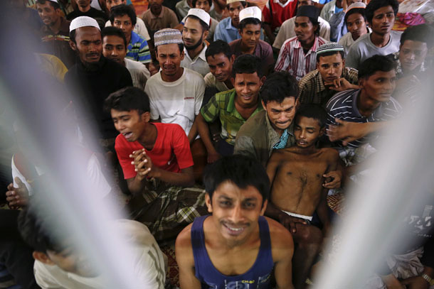 Rohingya people from Burma, who were rescued from human traffickers, react in a communal cell at the Songkhla Immigration Detention Center, where they are kept, near Thailand's border with Malaysia Feb. 13, 2014. (Photo: Reuters)