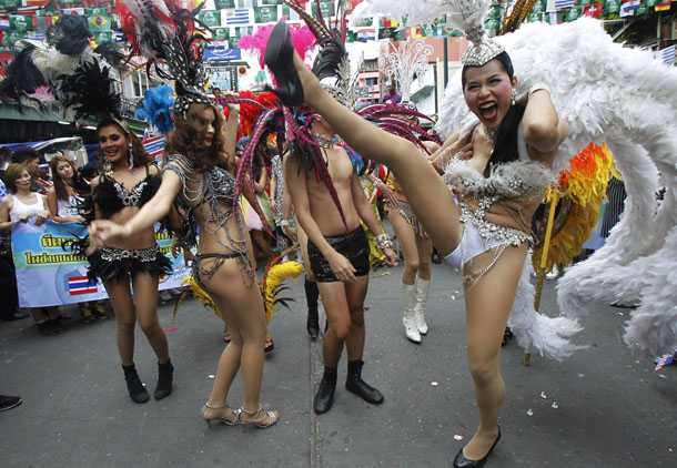 Dancers perform during a celebration to boost tourism on June 13 in Bangkok, where a curfew was in place after the military stages a coup. (Photo: Reuters)