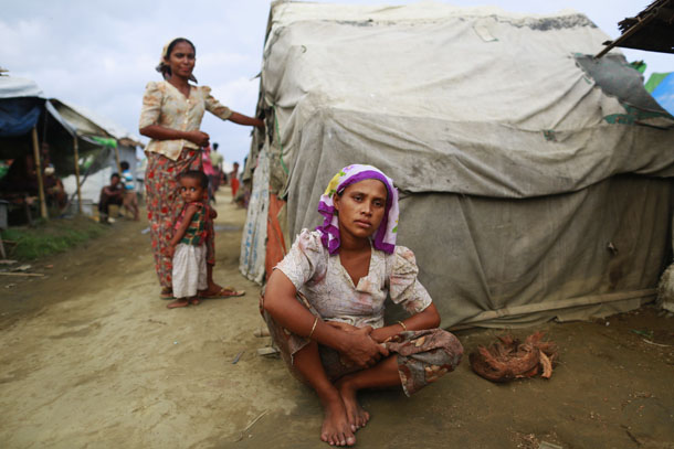 A 25-year-old Rohingya Muslim sits in front of her hut at a camp outside Sittwe. (Photo: Reuters)