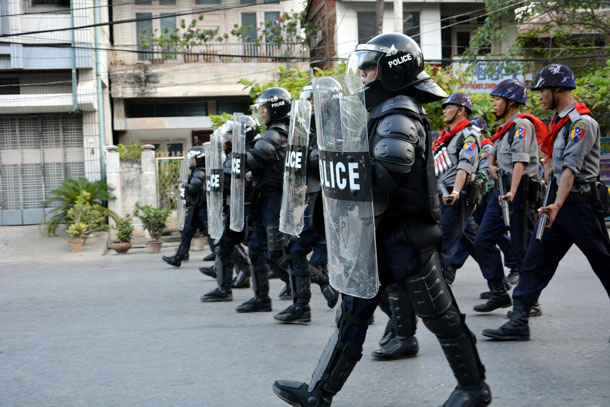 Police in riot gear and armed with teargas grenades were deployed to clear out the streets of central Mandalay on Friday evening. (Photo: The Irrawaddy)