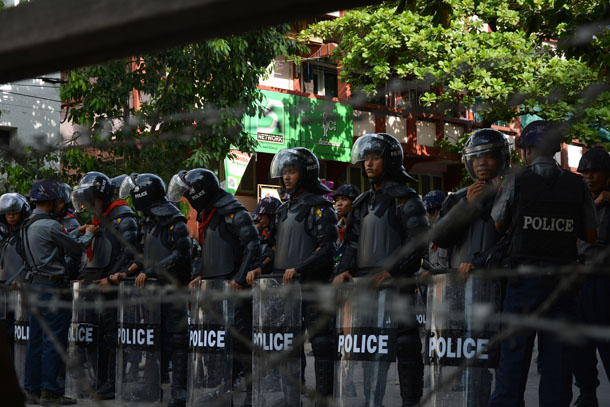 Security forces in riot gear line up in Mandalay on July 5. (Photo: Teza Hlaing / The Irrawaddy)