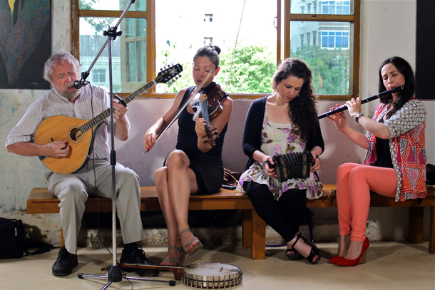 From left, Mick Moloney, a respected Irish musician, is accompanied by musicians Athena Tergis, Michelle Mulcahy and Louise Mulcahy during a performance in Yangon. (Photo: Jerry Peerson / The Irrawaddy)