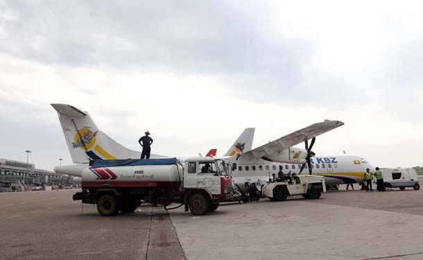 An Air KBZ plane refuels at Rangoon International Airport. (Photo: JPaing / The Irrawaddy)
