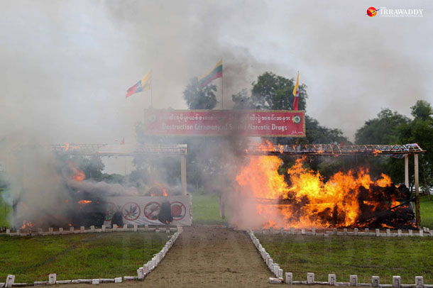 Drugs seized by Burmese authorities are burned in a ceremony in Rangoon's Mawbe Township last month. (Photos: Hein Htet / The Irrawaddy)