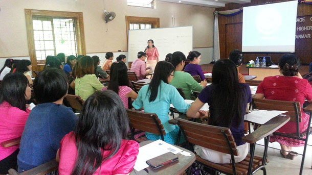 A coordinator from the eLibrary Myanmar project gives training to staff from the English Department at Rangoon University. (Photo: Facebook / Library of Yangon University)