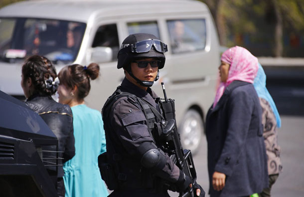 Police from a Special Weapons and Tactics team stand guard outside the South Railway Station in Urumqi, Xinjiang Uighur Autonomous Region, on May 1, 2014. (Photo: Reuters)