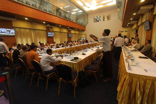 About 150 representatives from 66 political parties attended the meeting with President's Office Minister Aung Min and other members of the government's peace negotiating team at the Myanmar Peace Center on Monday. (Photo: Myanmar Peace Center / Facebook)