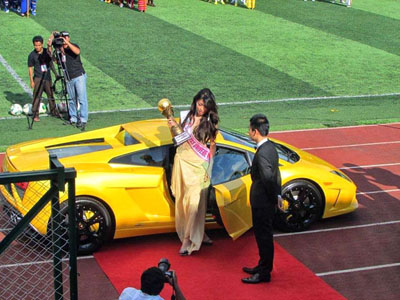 Than Shwe Grandson: In Oct. 2013 Nay Shwe Thway Aung, the grandson of former dictator Snr-Gen Than Shwe, was famously seen with a canary-yellow Lamborghini as the freshly crowned Miss Universe Myanmar, Ma Moe Set Wine, stepped out at a football stadium. (Photo: Facebook / The University Champions League)