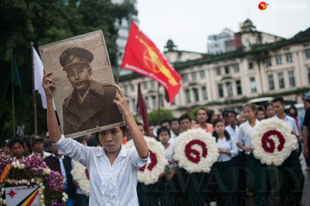"About 200 people marked the 26th anniversary of Burma's Aug. 8, 1988, uprising in Rangoon on Friday, holding aloft pictures of independence hero Gen. Aung San and holding wreaths bearing the Burmese numbers ""8888."" (Photo: Sai Zaw / The Irrawaddy)"